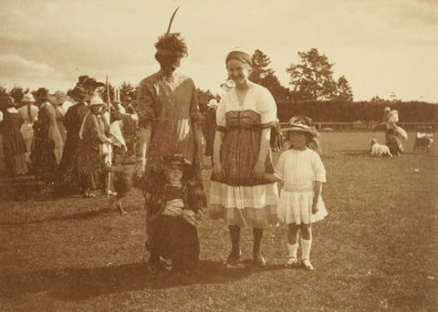 """The masked lady and her friends"": 'Armistice Celebrations in Levin, Nov. 13. 1918'. From the album: Family photograph album; 1917 - 1920; Adkin, Leslie - Museum of New Zealand Te Papa Tongarewa"